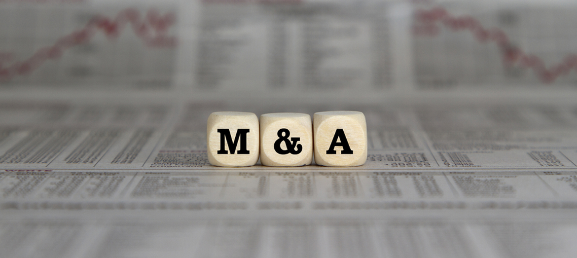 Image of dice that say M&A to represent mergers & acquisitions