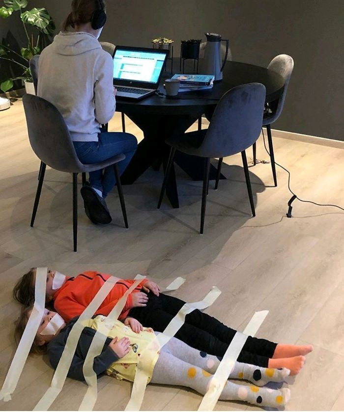 Kids taped to floor so mom can join videoconference